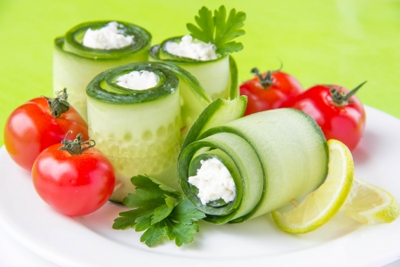 Cucumber rolls with cheese and tomato Stock Photo - 18369816
