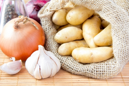 fingerling: Sack of potatoes with onion and garlic