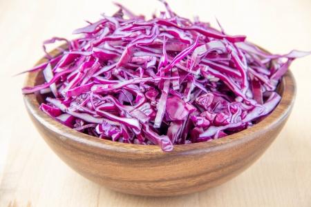 shredded: Shredded red cabbage in wooden bowl