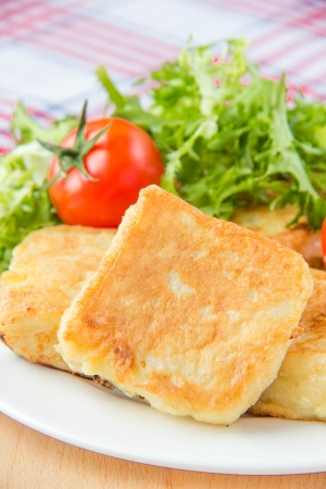 Fried sandwiches with mozzarella and eggs on  white plate with tomato photo