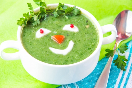 fresh spinach: Vegetable green soup with a smiling face