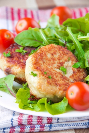 Grilled meat cutlet with a fresh green salad for dinner photo