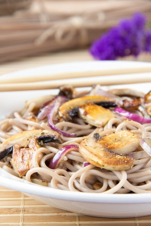 buckwheat noodle: Asian vegetarian meal - buckwheat noodles with champignon and onion