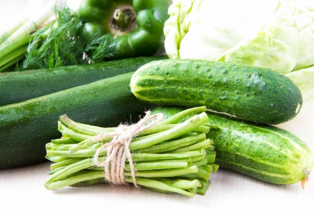leguminous: Assortment of fresh green vegetables for health - cucumbers, zucchini, leguminous green beans, peppers Stock Photo