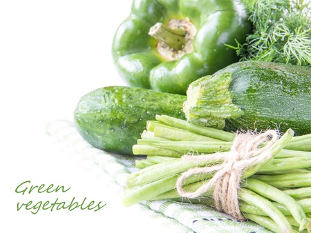 leguminous: Assortment of fresh green vegetables for health as a background - cucumbers, zucchini, leguminous green beans, peppers Stock Photo