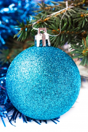weighs: Brilliant blue ball weighs on Christmas tree, isolated on white Stock Photo