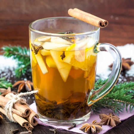 Spicy hot tea with apple and orange, cinnamon, star anise, Christmas drink