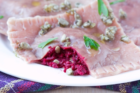 Italian pink pasta ravioli with beet filling, tasty dish photo