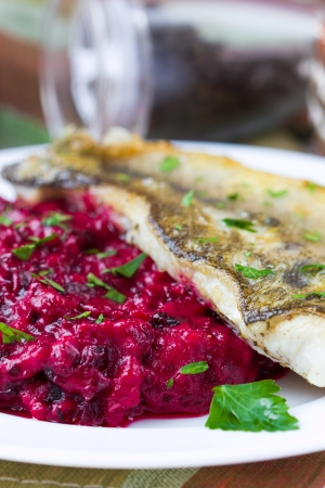 Fried fish fillet of perch with mashed beet and potato, tasty dish for restaurant photo