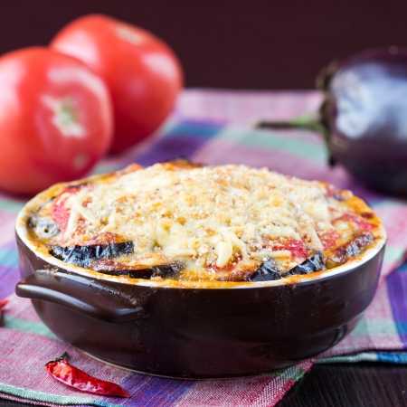 Tasty Italian dish, appetizer with eggplant, cheese and tomato sauce in cup photo