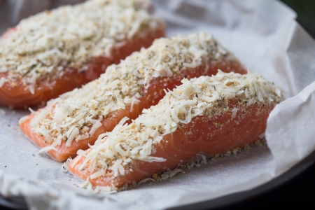 breading: Fresh raw steak fillet of red fish salmon with cheese breading crust