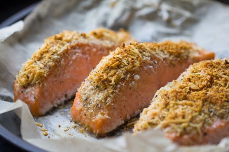 breading: Steak fillet of red fish salmon with cheese crust breading in baked form Stock Photo
