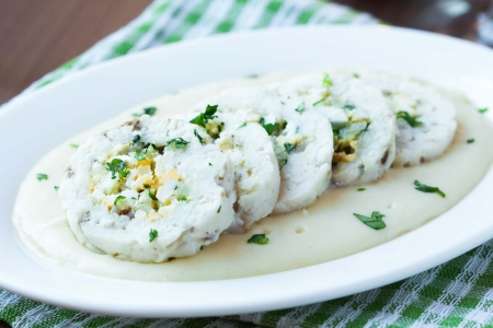 Roulade roll of white fish fillet cod stuffed with egg, sauce bechamel, tasty diet dish photo