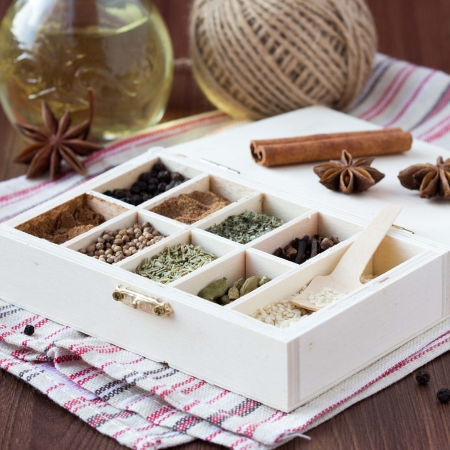 Assortment collection of spices and herb in wooden box, food background photo