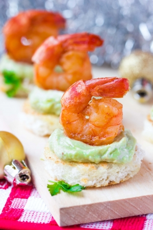 Shrimp on toast with guacamole sauce avocado, Christmas tasty elegant appetizer, starter for new year party photo