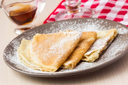 Thin sweet pancakes with powdered sugar for Breakfast, Maslenitsa, Shrovetide 版權商用圖片