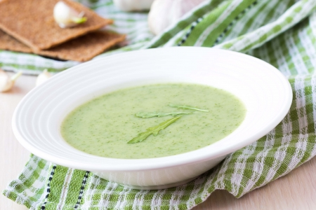 Green garlic cream soup with leaves rukola, arugula, healthy dietary vegetable dish photo