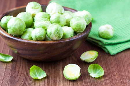 Brussels sprouts in a wooden bowl on the table, tasty, healthy vegetable bio products photo