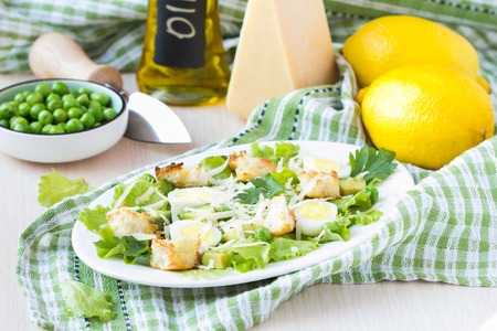 Fresh spring salad with lettuce, eggs, cheese, croutons, green peas, healthy diet lunch photo