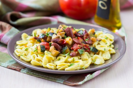meagre: Italian pasta orecchiette with stew of vegetables and beans, delicious homemade meals Stock Photo