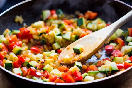meagre: Cooking stew ratatouille from vegetables in frying pan, delicious vegetarian french dish