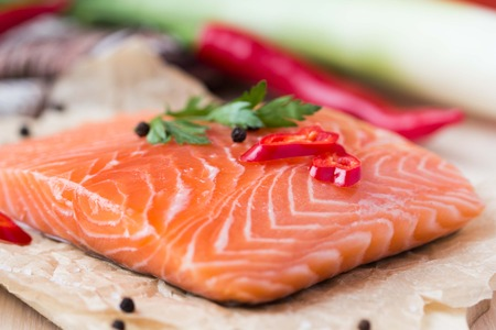 Raw fillets of red fish, salmon, cooking healthy diet dishes for dinner photo