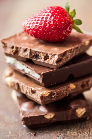 Chocolate stack, mixed, range, strawberry, nuts, marzipan, tasty sweet snack photo