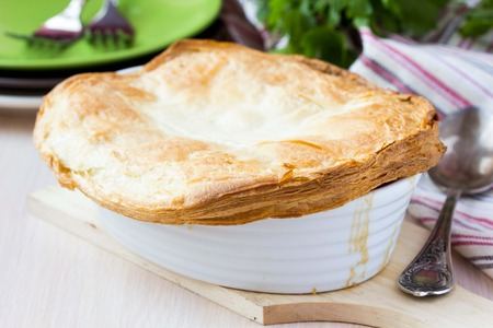 Meat pie with stew of chicken, mushrooms, peas, puff pastry crust, tasty homemade dish photo