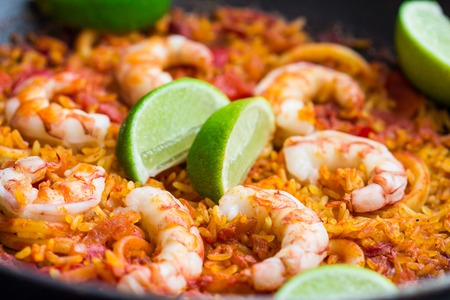 Spanish dish paella with seafood, shrimps, squid, rice, saffron, traditional tasty dinner photo