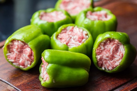 Green peppers, prepared for cooking stuffed paprika with raw meat and rice, homemade dish photo