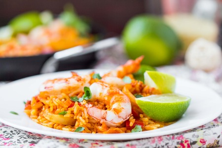 Spanish dish paella with seafood, shrimps, squid, rice, saffron, traditional tasty dinner Stock Photo