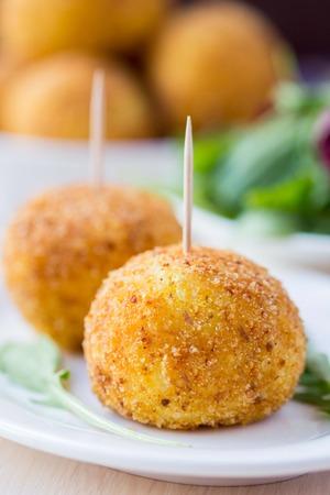 balls deep: Italian appetizer arancini, rice balls stuffed with meat cooked in deep fat