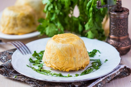 azerbaijani: Oriental shah pilaf, pilaw, plov, rice with meat in pastry filo, delicious fragrant spicy dish