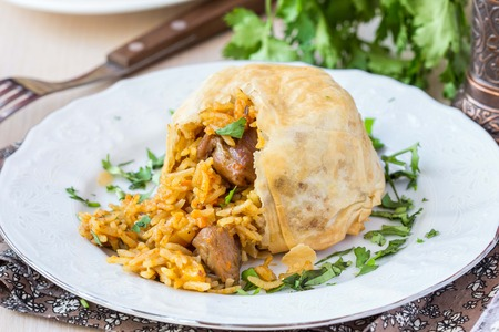 shah: Oriental shah pilaf, pilaw, plov, rice with meat in pastry filo, delicious fragrant spicy dish