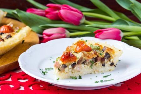 French pie quiche with tomato, ham, egg, cheese, mushrooms, tasty dish photo