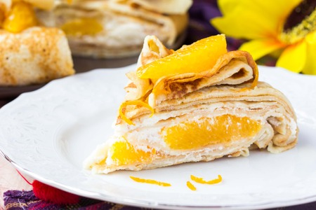 pancake week: Pancake cake with oranges, whipped cream, delicious breakfast on Shrove Tuesday Stock Photo