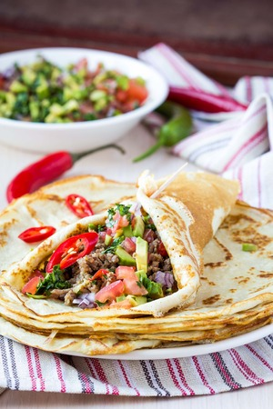 shrove: Pancakes stuffed with meat, avocado, tomatoes, onions, Mexican taste, Russian Shrove Stock Photo