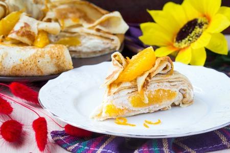 shrove tuesday: Pancake cake with oranges, whipped cream, delicious breakfast on Shrove Tuesday Stock Photo
