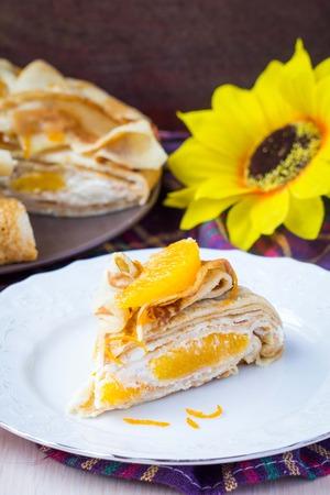 shrove: Pancake cake with oranges, whipped cream, delicious breakfast on Shrove Tuesday Stock Photo