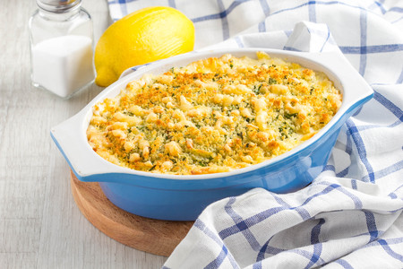 Casserole with crispy crumble, potato gratin, baked meat butter cheese dish, delicious homemade dinner Archivio Fotografico