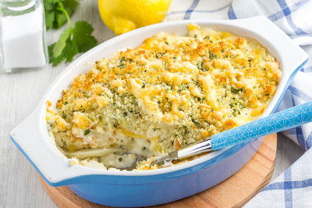Casserole with crispy crumble, potato gratin, baked meat butter cheese dish, delicious homemade dinner Stockfoto