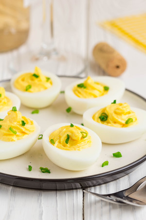 Stuffed eggs, yellow mousse, wine snack, holiday party