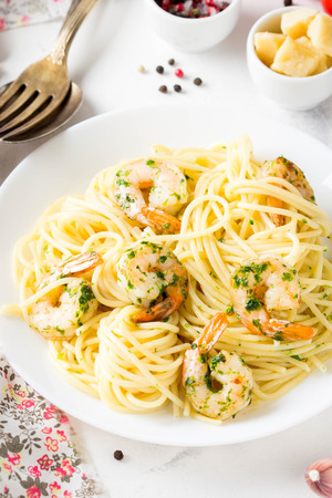 Italian pasta, spaghetti with shrimp, herbs, garlic and cheese. Delicious healthy food