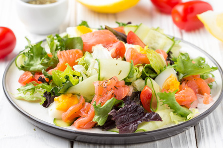 Salad with salmon, egg and vegetables (cherry tomatoes, cucumber, lettuce), delicious light lunch, healthy food Stock fotó