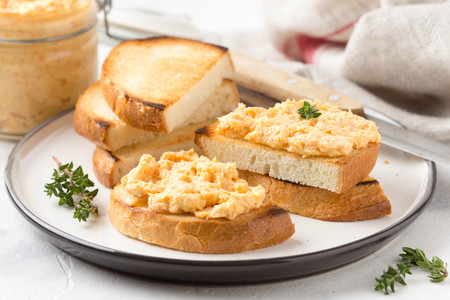 Chicken pate with carrots on toast bread, delicious spread for Breakfast. Healthy food, vegetable snack, wine aperitizer