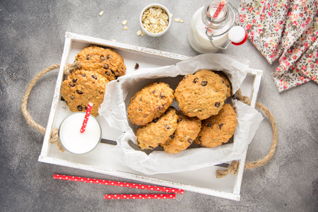 Homemade oatmeal cookies with chocolate and banana, milk in a glass with a tube. Delicious dessert, Breakfast (lunch), healthy food, pastries for children