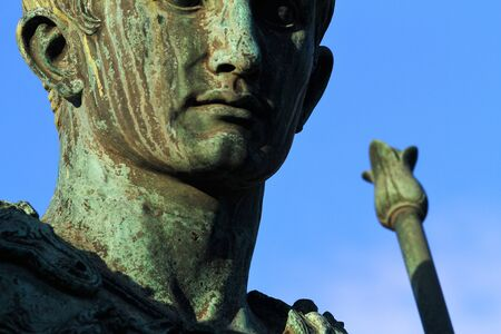 Detail of the face of the bronze statue of the Roman emperor Augustus in Via dei Fori Imperiali in Rome