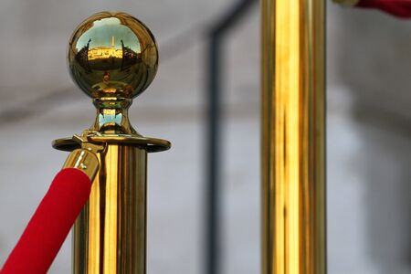 Brass stanchion with red velvet rope. The knob reflects Piazza Navona in Rome