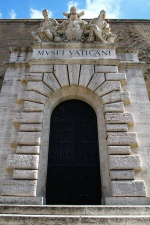 Main entrance of the Vatican museums. Portal with sculptural marble group. Archivio Fotografico