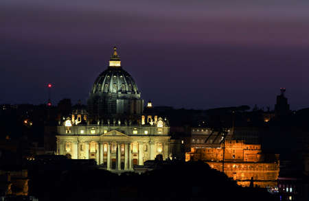 Night panorama of Rome with St. Peter's Basilica and Castel Sant'Angelo.